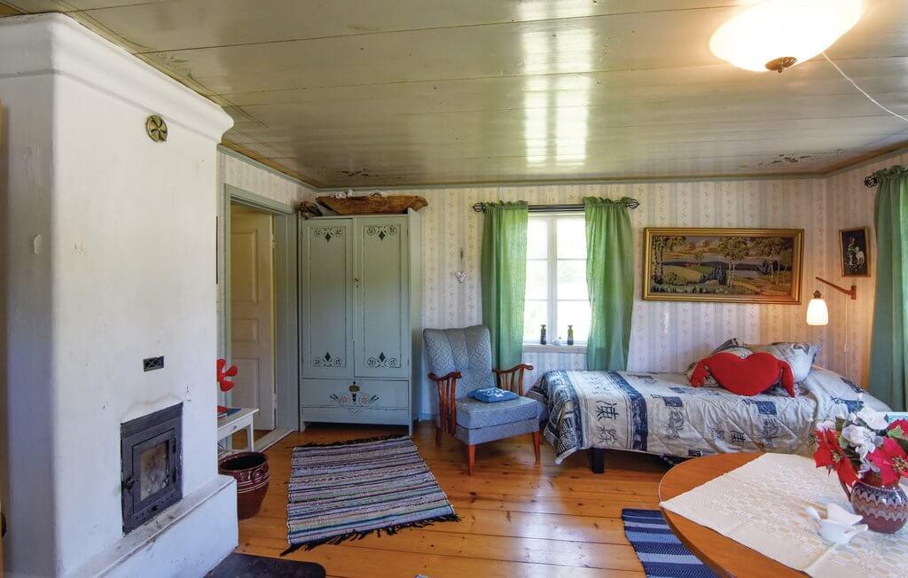 Schweden Ferienhaus Ambjoernarp-schwedenstube Wohnzimmer2